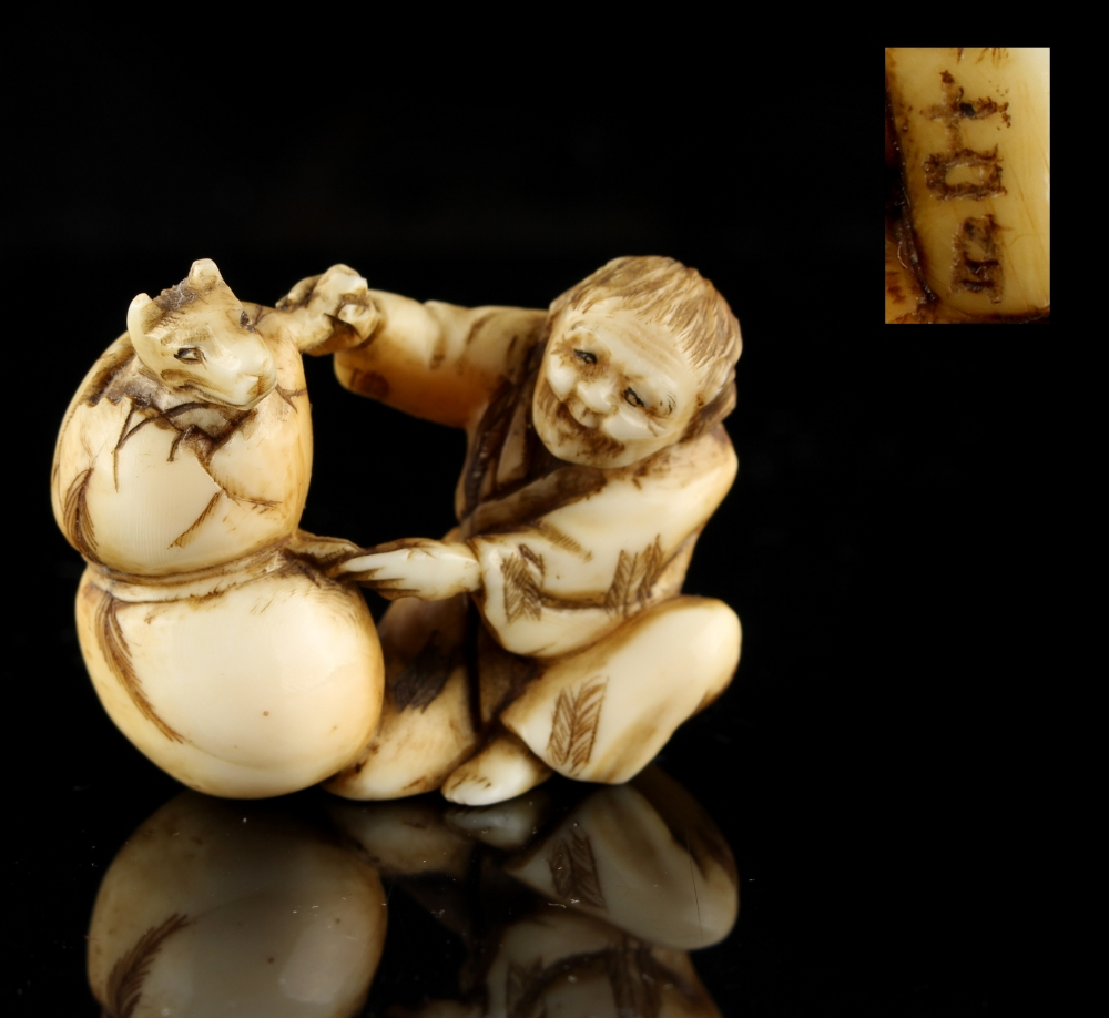 Lot 54 - The Ronald Hart Collection of Japanese Netsukes - a carved ivory netsuke modelled as a seated figure