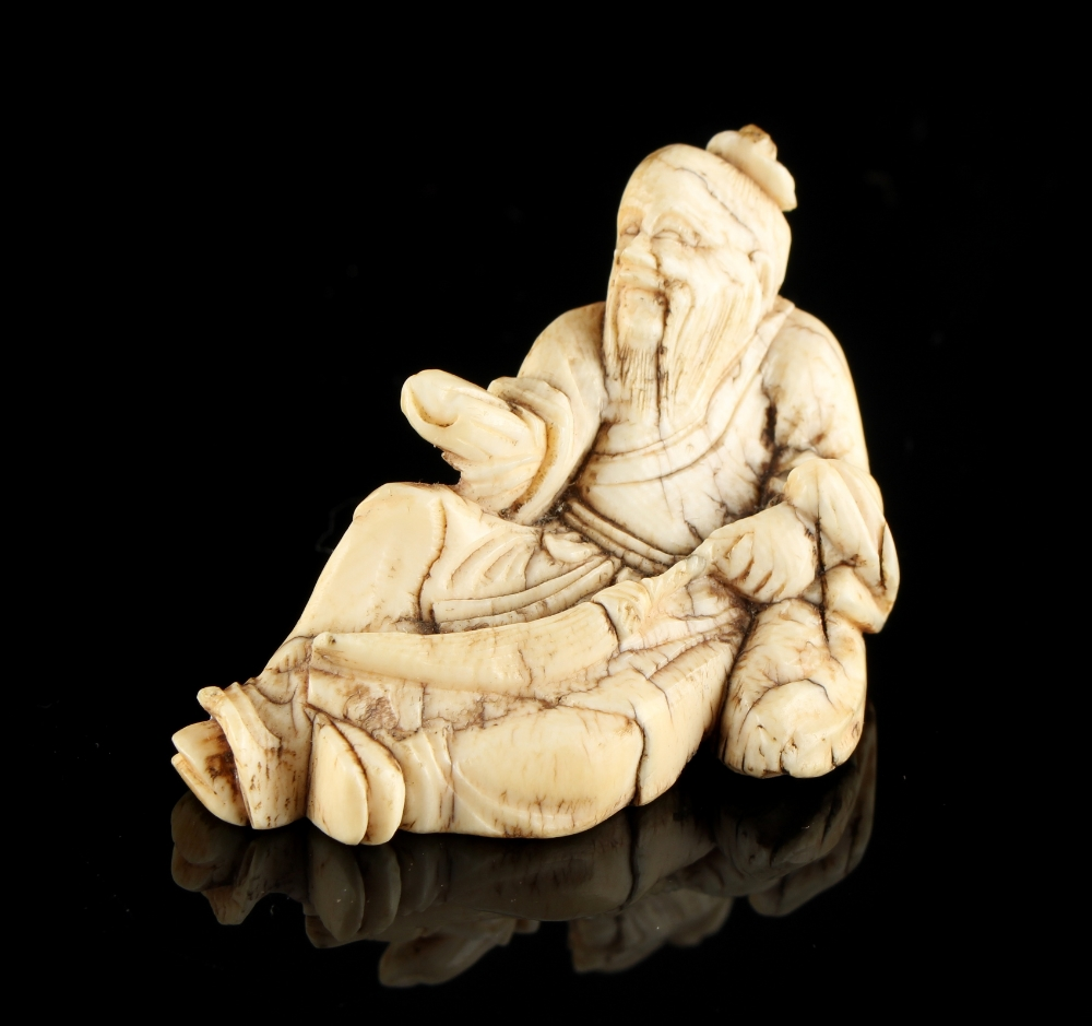 Lot 58 - The Ronald Hart Collection of Japanese Netsukes - a carved ivory netsuke modelled as a recumbent