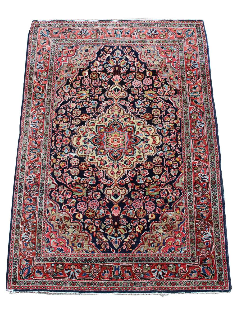 Lot 24 - Property of a gentleman - a mid 20th century Persian Kashan rug, with navy field, 61 by 42ins. (