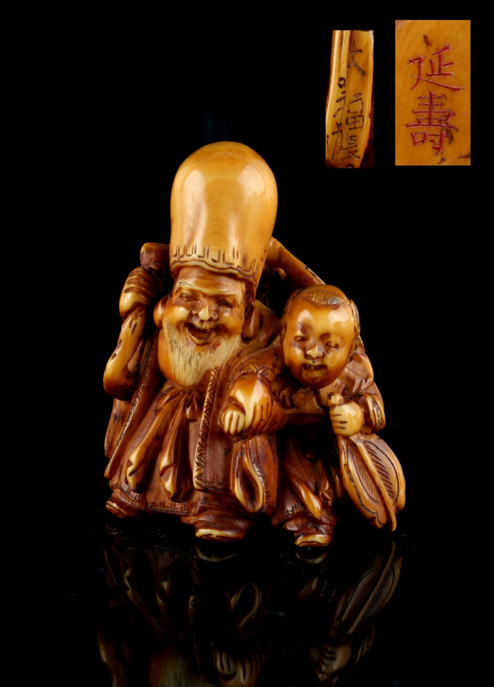 Lot 51 - The Gill Collection of Japanese Netsukes - a carved ivory netsuke modelled as Fukurokuju with a boy,