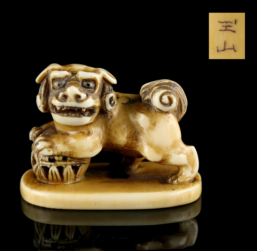 Lot 52 - The Gill Collection of Japanese Netsukes - a carved ivory netsuke modelled as a standing