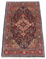 Lot 25 - Property of a gentleman - a mid 20th century Persian Kashan rug, with navy field, 64 by 42ins. (