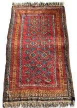 Lot 29 - Property of a gentleman - a Belouch rug, mid 20th century, 70 by 44ins. (178 by 112cms.) (see