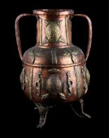 Lot 5 - A Middle Eastern Islamic copper & brass two-handled vessel, 19.3ins. (49cms.) high (see