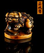 Lot 53 - The Gill Collection of Japanese Netsukes - a carved ivory netsuke modelled as a standing karashishi,