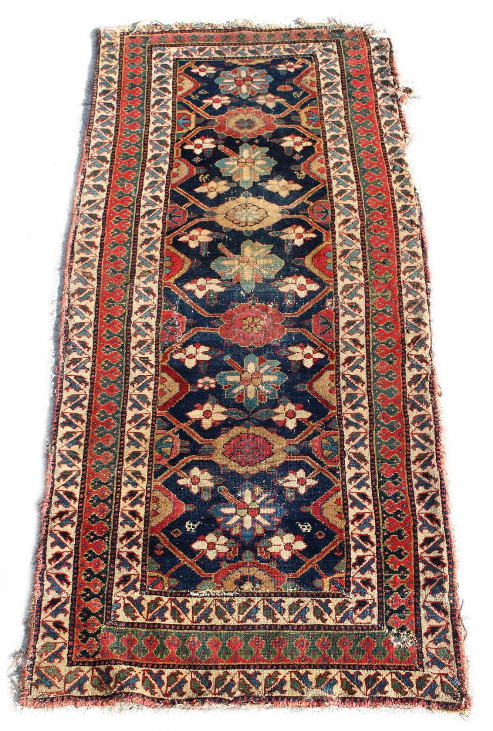 Lot 38 - Property of a gentleman - a mid 19th century Northwest Persian rug, reduced in length, damages, 84