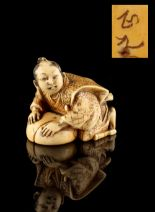 Lot 55 - The Ronald Hart Collection of Japanese Netsukes - a carved ivory netsuke modelled as a man