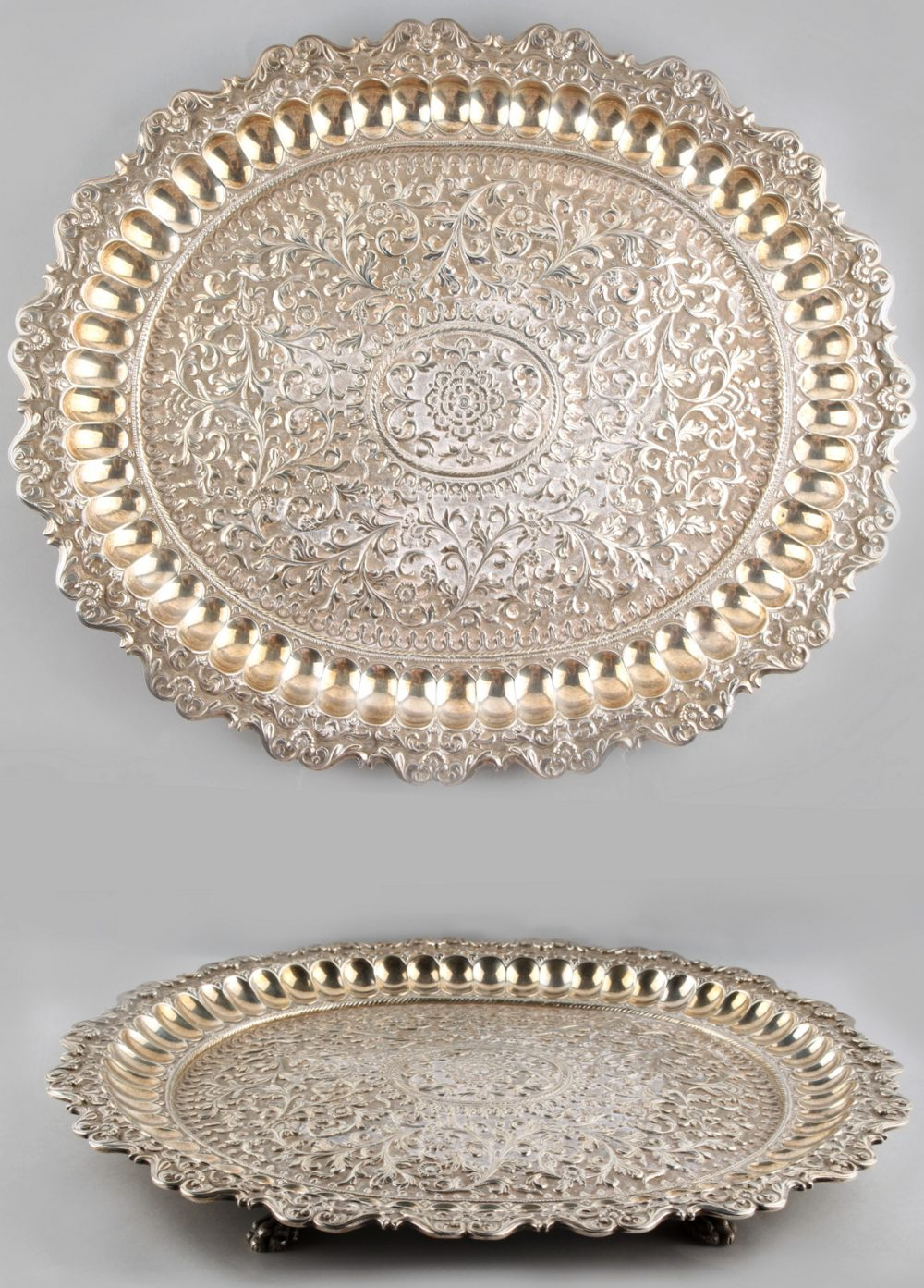 Lot 1 - Property of a lady - a late 19th / early 20th century Indian silver oval tray, raised on paw feet,