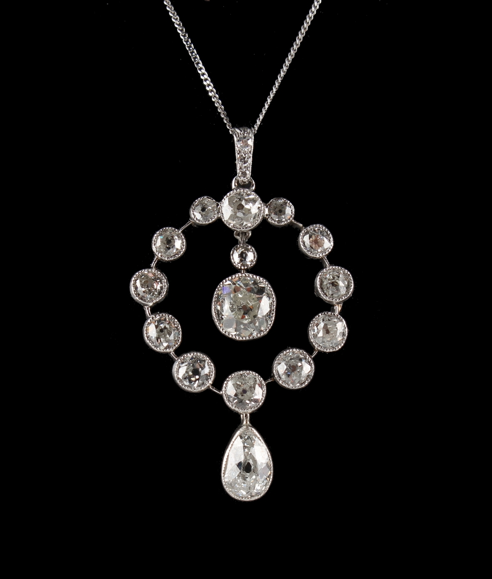 Lot 263 - A good diamond pendant on chain necklace, with a pear shaped diamond suspended below a ring of