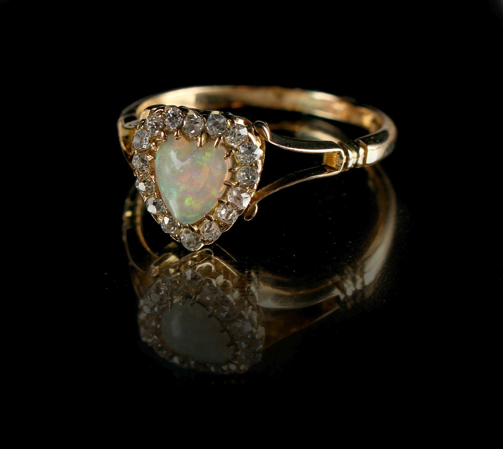 Lot 239 - A late Victorian 18ct yellow gold opal & diamond ring, the heart shaped opal in conforming setting