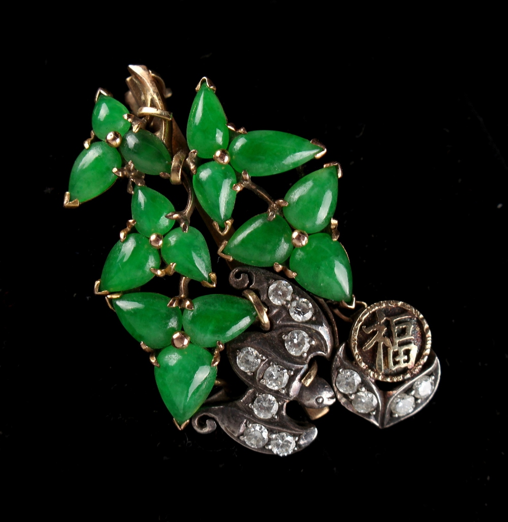 Lot 213 - A Chinese Imperial jadeite & diamond brooch modelled as stylised leaves flanked by a diamond set bat