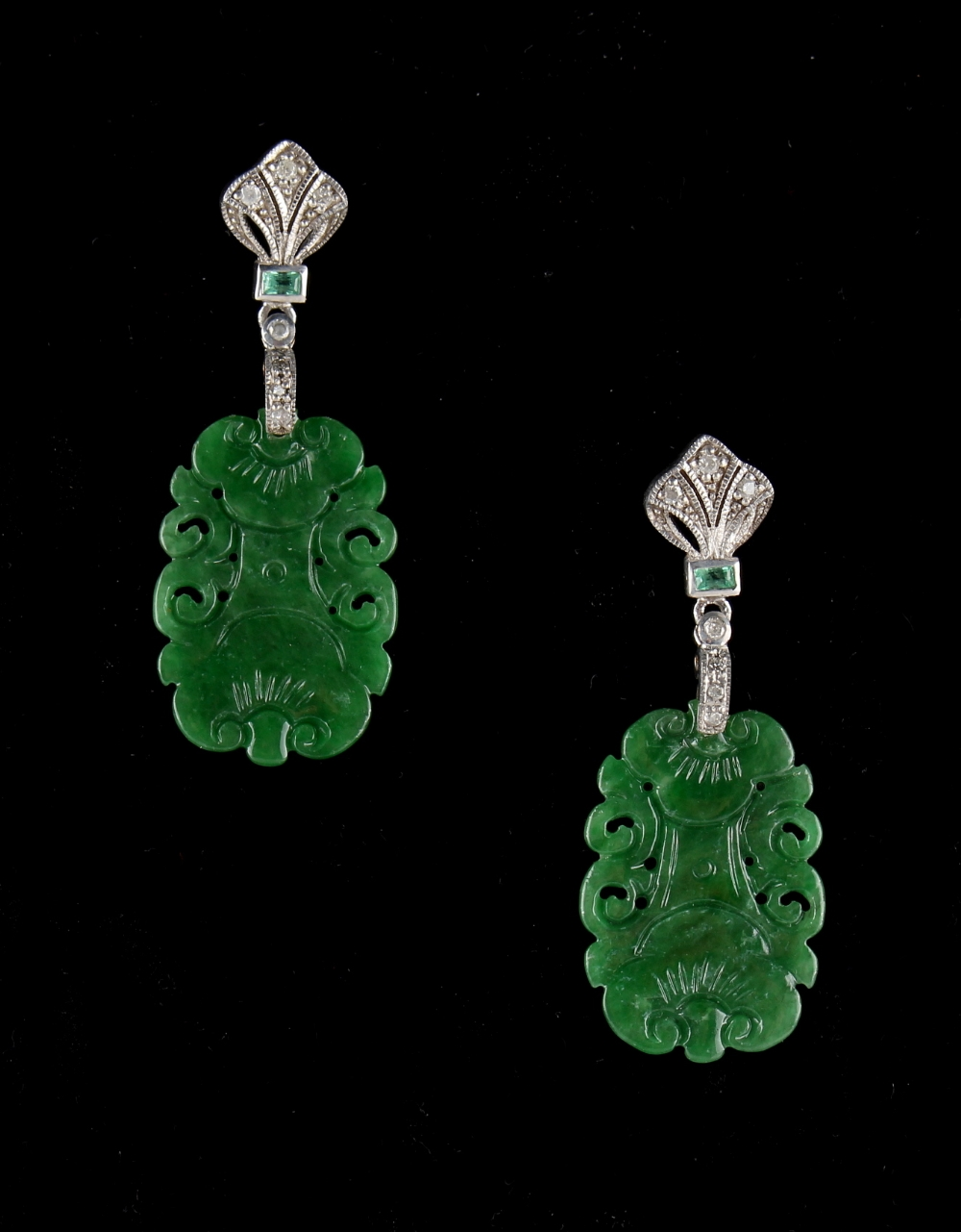 Lot 224 - A pair of Chinese carved jadeite & diamond pendant earrings, the apple green jadeite plaques each