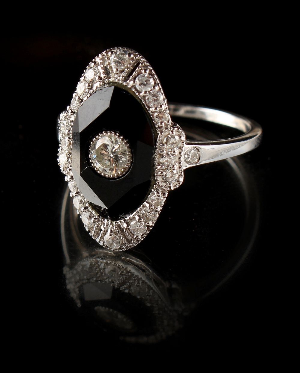 Lot 233 - An Art Deco 18ct white gold diamond & black onyx ring, with oval setting, the estimated total