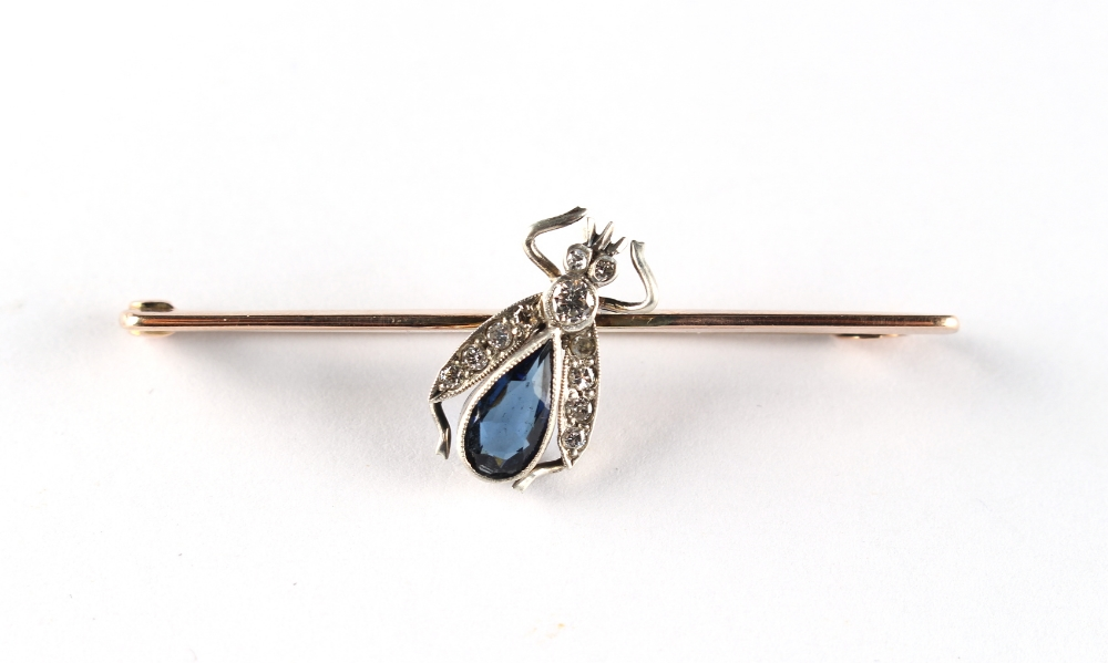 Lot 228 - A 9ct yellow gold sapphire & diamond bug brooch, the pear shaped sapphire approximately 8.5mm