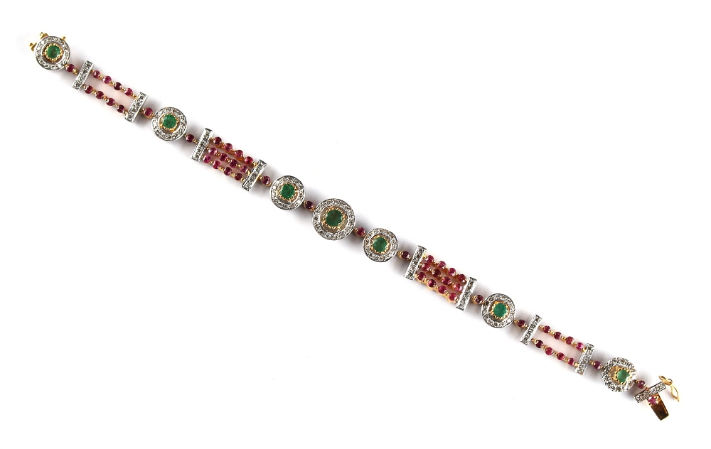 Lot 267 - A ruby emerald & diamond link bracelet, with alternating two & three row strings of round cut rubies