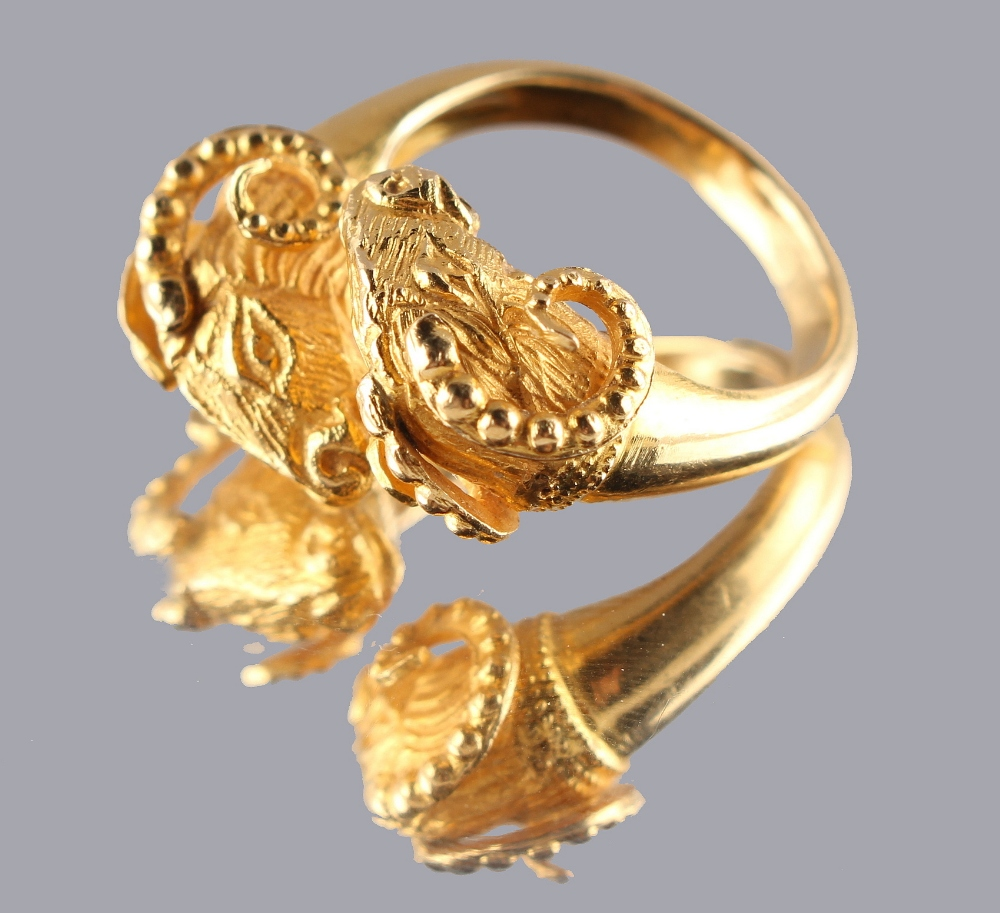 Lot 218 - An 18ct yellow gold twin ram's head ring, possibly by Ilias Lalaounis, approximately 8.8 grams, size