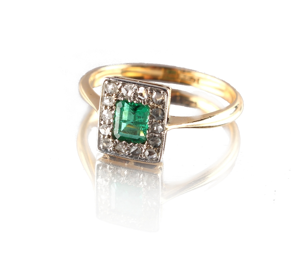 Lot 269 - An 18ct yellow gold emerald & diamond ring, the rectangular cut emerald of clear vibrant colour