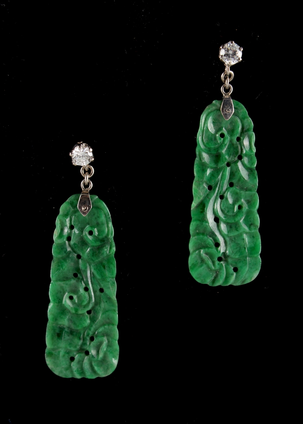Lot 214 - A pair of Chinese carved & pierced jadeite pendant earrings, the certificated untreated jadeite