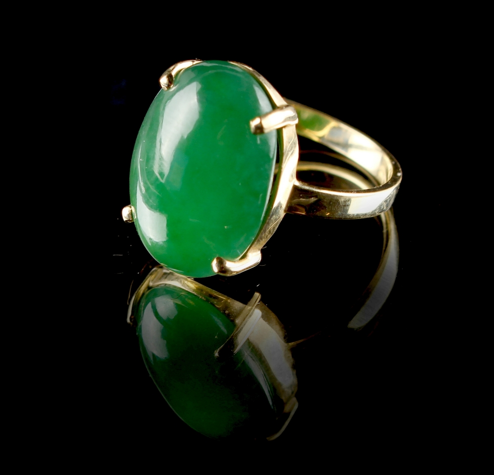 Lot 223 - A Chinese oval jadeite ring, the certificated untreated cabochon jadeite of even colour, measuring