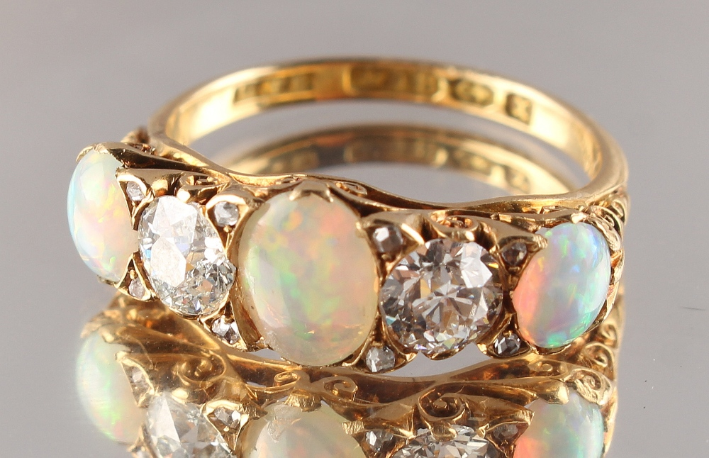 Lot 242 - A late Victorian 18ct yellow gold opal & diamond five stone ring, with three oval opals