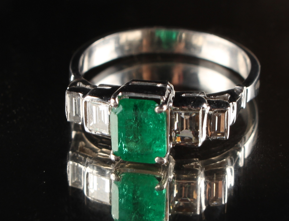 Lot 236 - An Art Deco style unmarked white gold emerald & diamond ring, the octagonal cut Colombian emerald