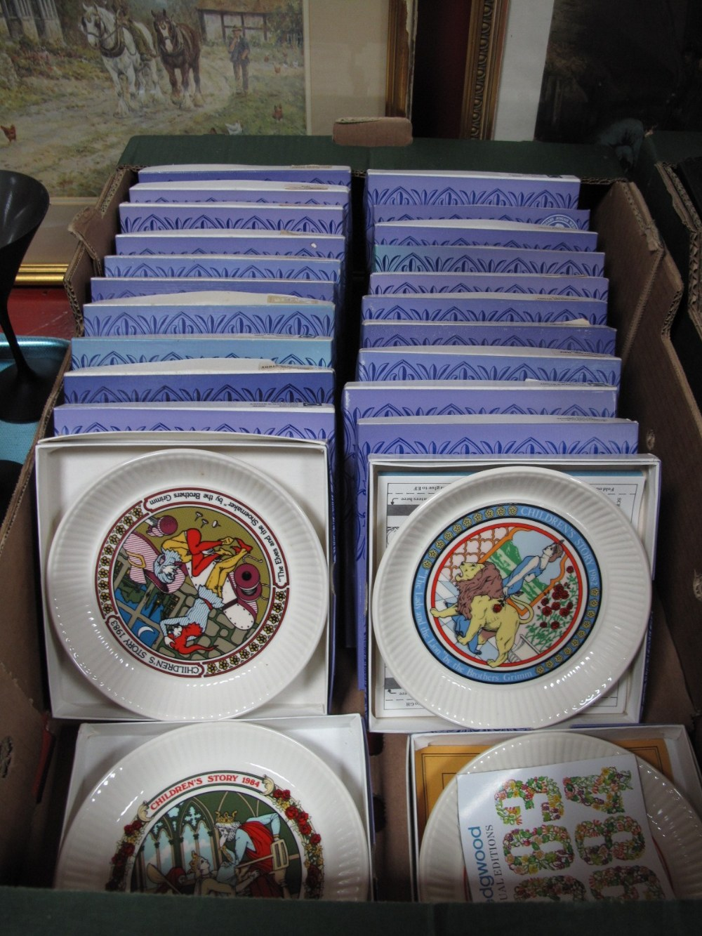 "Lot 10 - A Collection of Wedgwood ""Children's Stories"" Year Plates, (twenty four plates):- One Box"