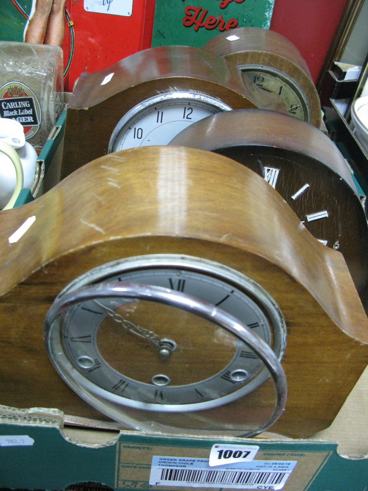 Lot 1007 - Four Mid XX Century Walnut Cased Mantel Clocks - in need of restoration:-. One Box