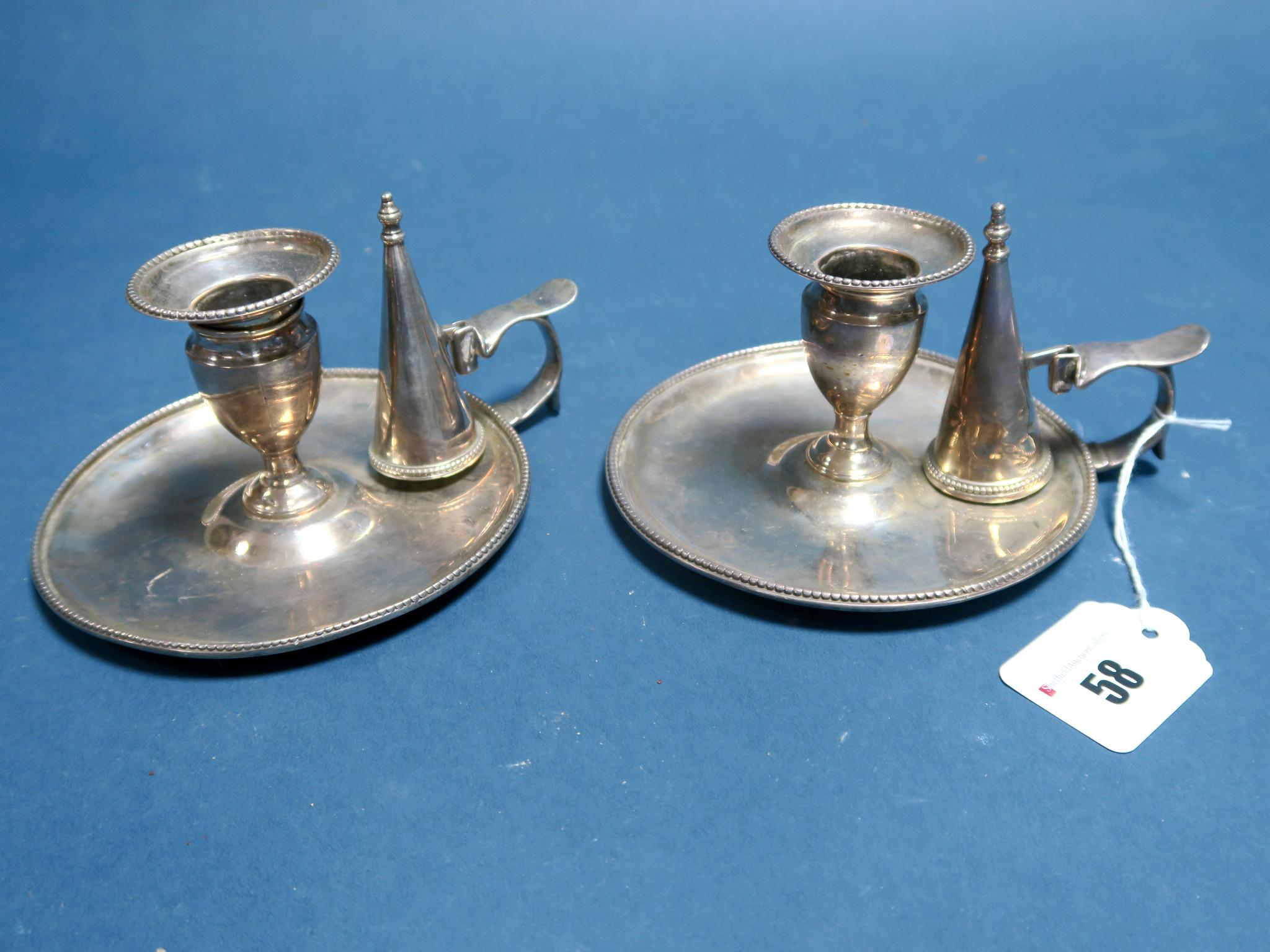 Lot 58 - A Matched Pair of Hallmarked Silver Chambersticks, J.A, London 1818, 1819, each of plain design,