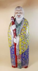 Lot 38 - A large early 20th century Chinese famille rose figure of Shoulau, the face originally having real