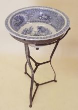 Lot 4 - A 19th century blue and white pottery wash basin on metal stand