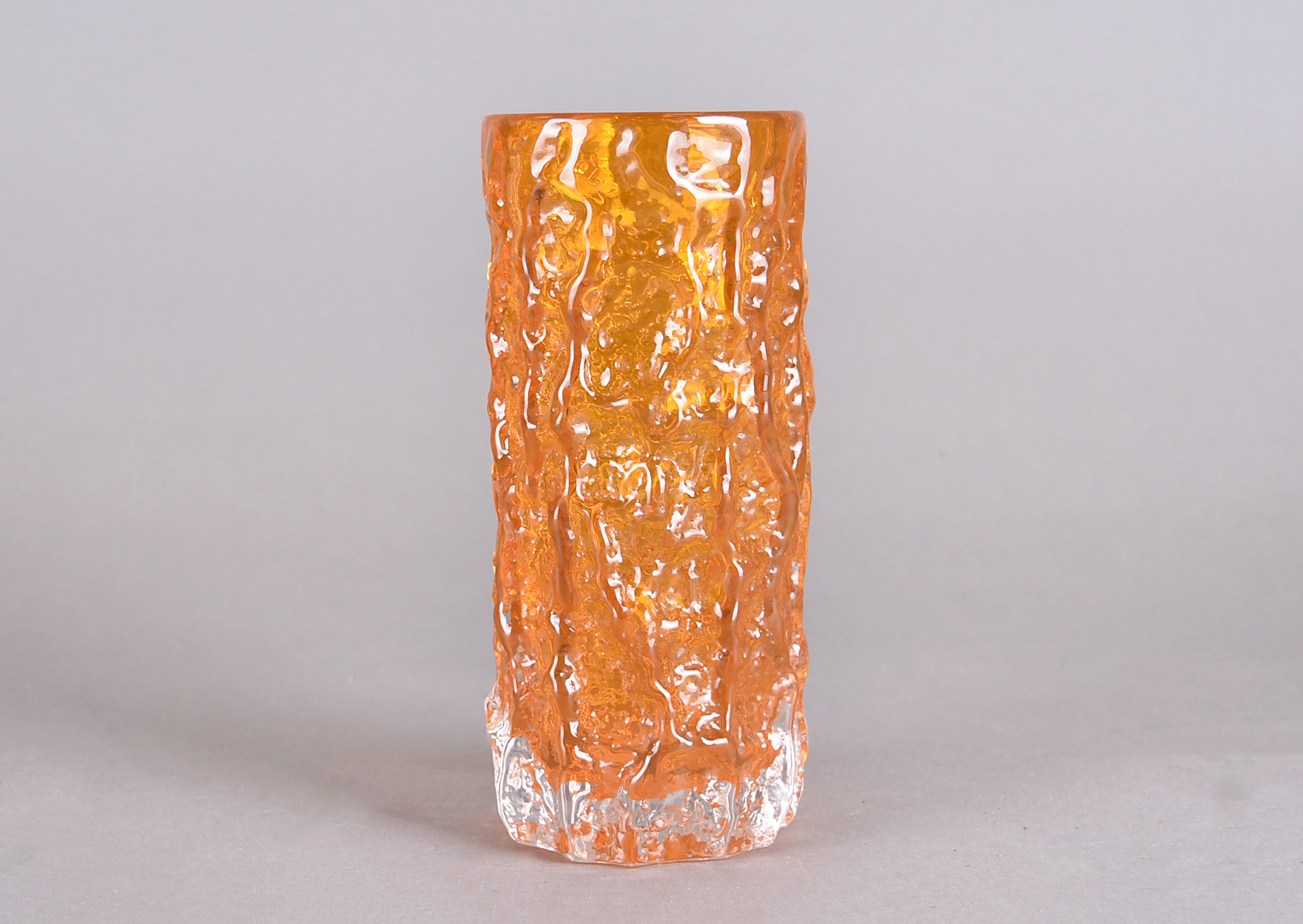 A Whitefriars tangerine glass 'Bark' vase by Geoffrey Baxter, from 'Textured' range, pattern