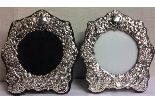 Lot 40 - A PAIR OF SILVER STRUT PICTURE FRAMES With relief decoration of cherubs. (18cm x 16cm)