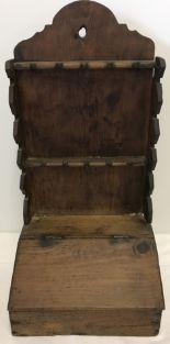 Lot 127 - A Georgian pine spoon rack with lift up lidded cutlery box.