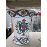 A vase with armorial decoration and crossed swords mark.