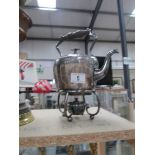 A silver plate spirit kettle with burner.