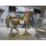 A solid brass horse.