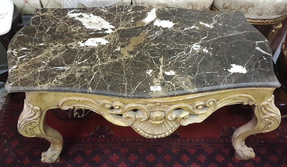 "Lot 22 - Carved gilt wood decorative low Table with a black marble top (corner chipped) 38""w x 23""d"