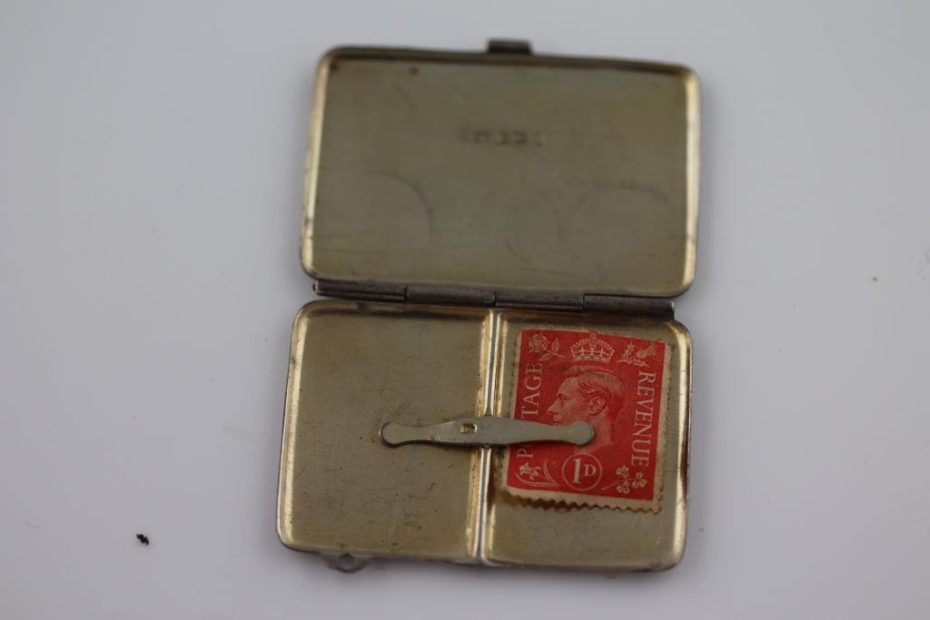 Lot 53 - An early George V silver double stamp case, Sheffield 1913, Joseph Rogers and Sons, gilt interior,