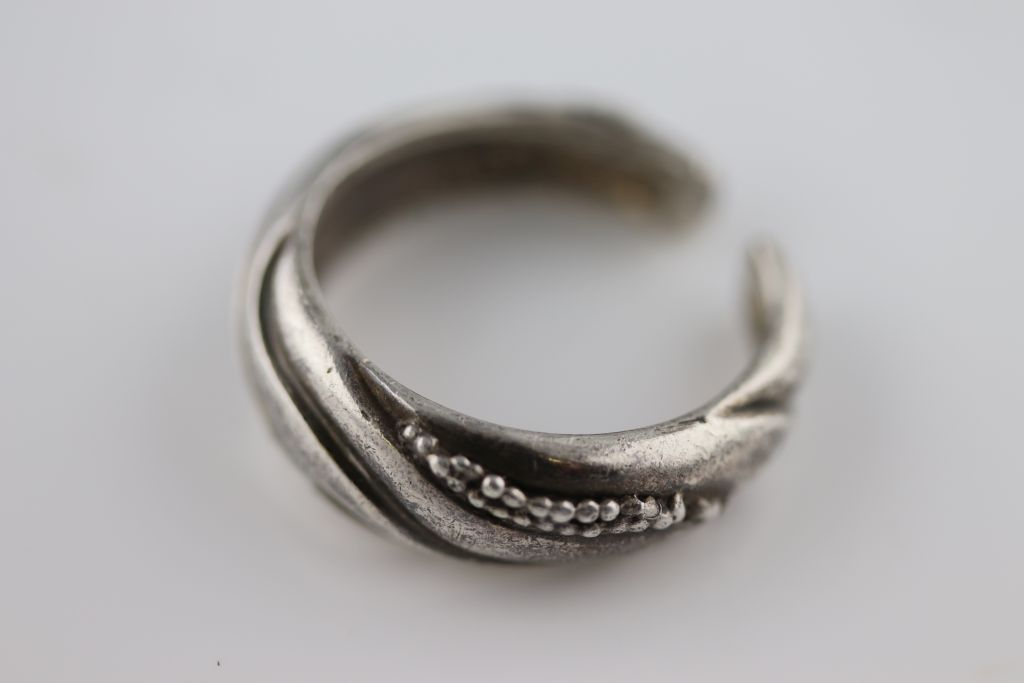 Lot 39 - Georg Jensen: a Danish silver earring, banded wave design with bead clusters, signed, pattern number