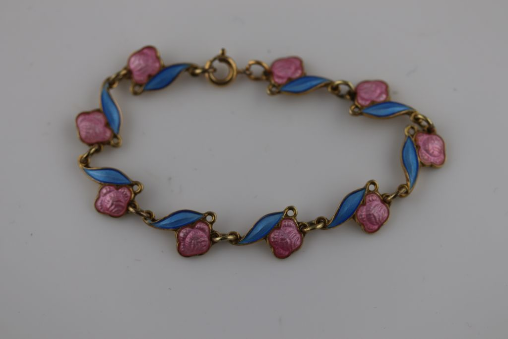 Lot 32 - Arne Nordlie, a Norwegian enamelled silver gilt child's bracelet, pink enamelled roses attached to