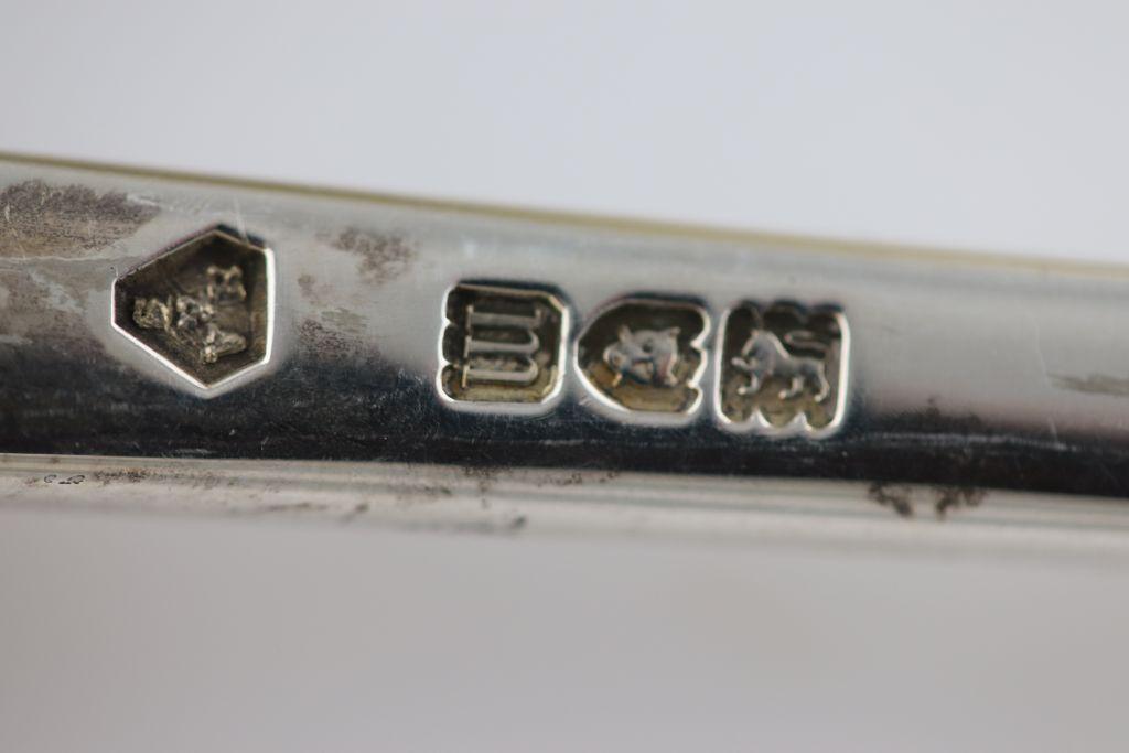 Lot 59 - Five Edwardian silver rat tail pattern serving spoons, London 1907 Holland, Aldwinckle & Slater,
