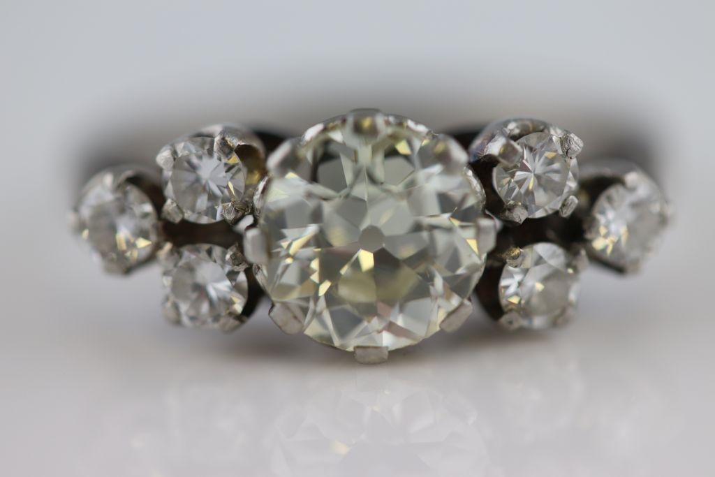 Lot 20 - A circa 1930s 1.40 carat diamond 18ct white gold platinum set ring, the round old cut diamond