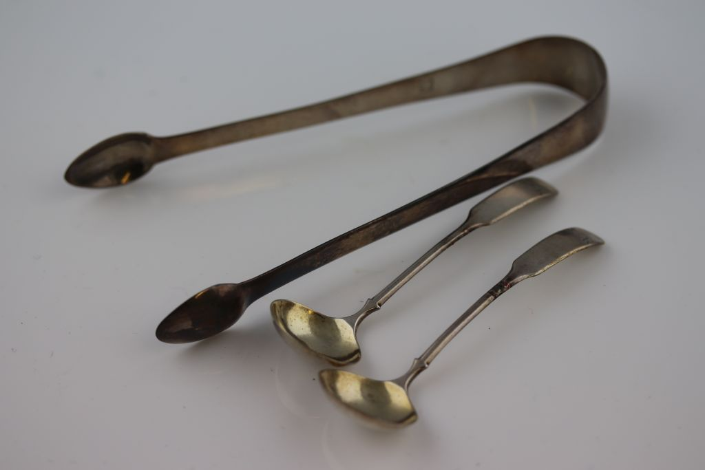 Lot 28 - Georgian hallmarked Silver pair of Sugar tongs, maker marks TW & JH and a pair of Georgian Silver