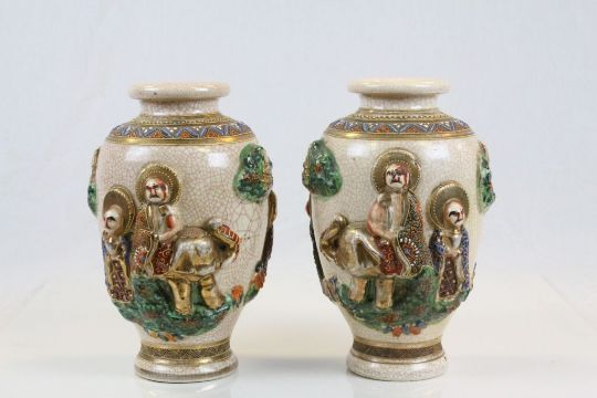 Pair Of Japanese Satsuma Style Vases Featuring Religious Figures In