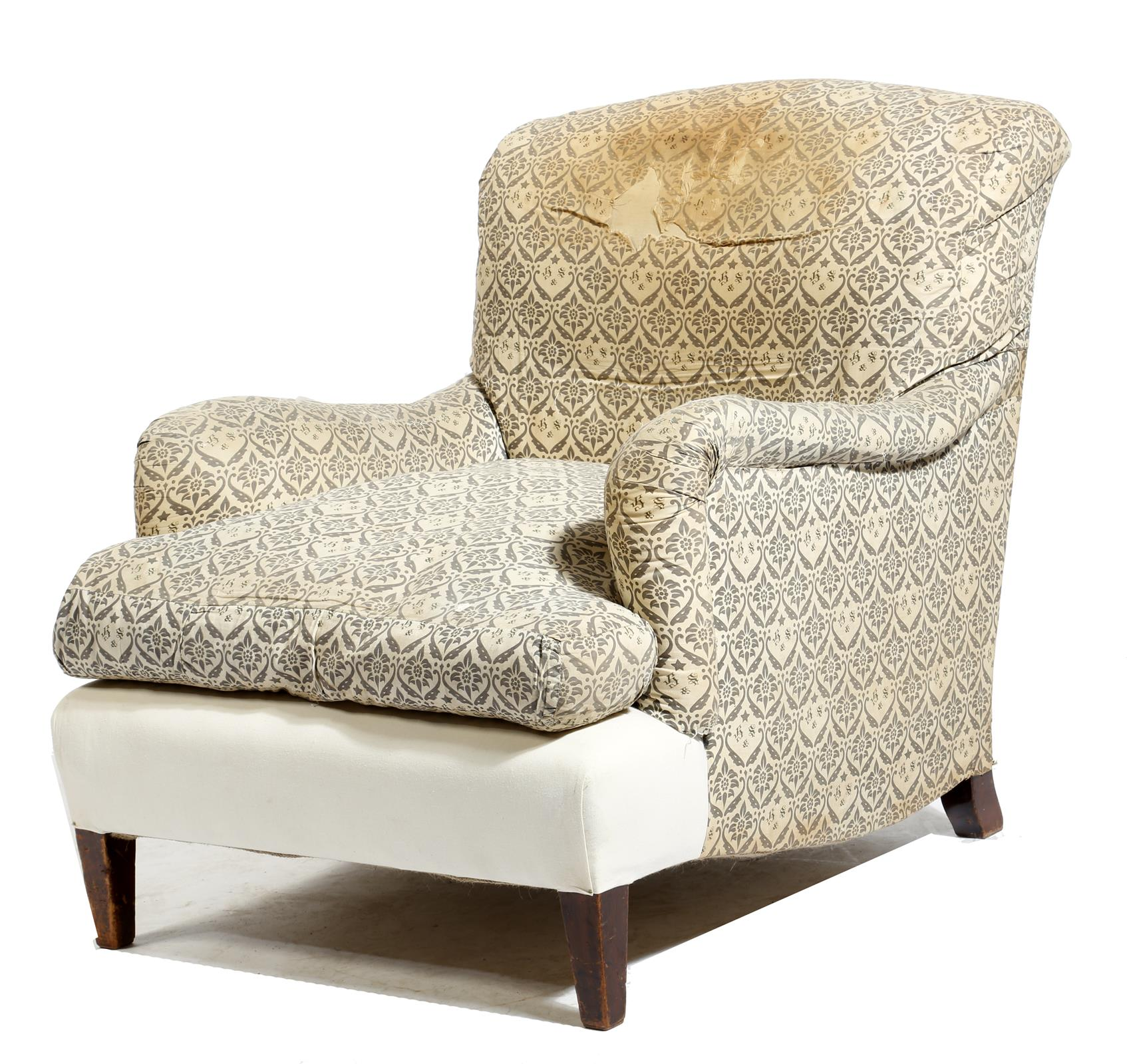 Lot 710 - An easy armchair by Howard & Sons Ltd., covered with part 'H & S' monogrammed ticking, on square