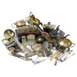 λ A mixed lot, comprising silver items: a three-piece tea set of panelled form, Birmingham 1918, a