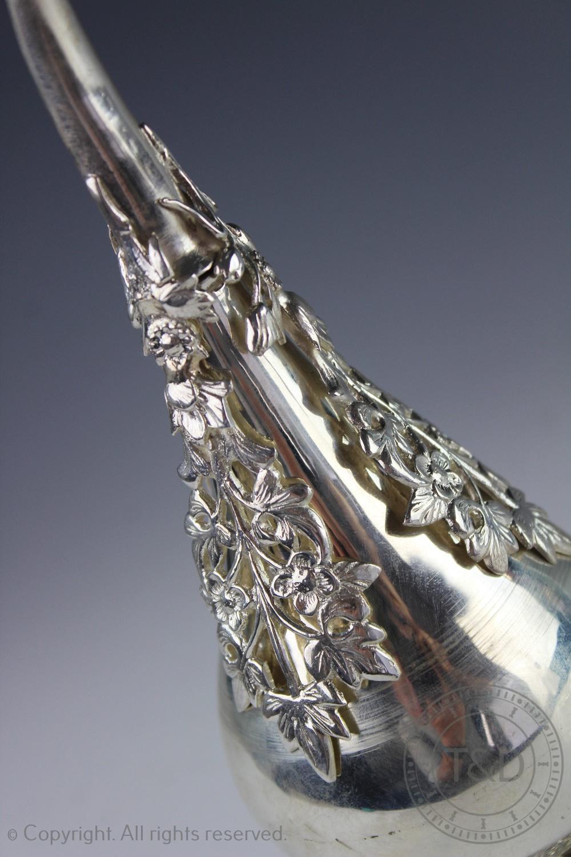 Lot 58 - An Ottoman white metal rose water sprinkler/aspergillum,