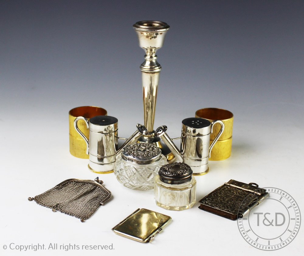 Lot 57 - A selection of silver and silver plated items to include; a silver candlestick, A T Cannon Ltd,