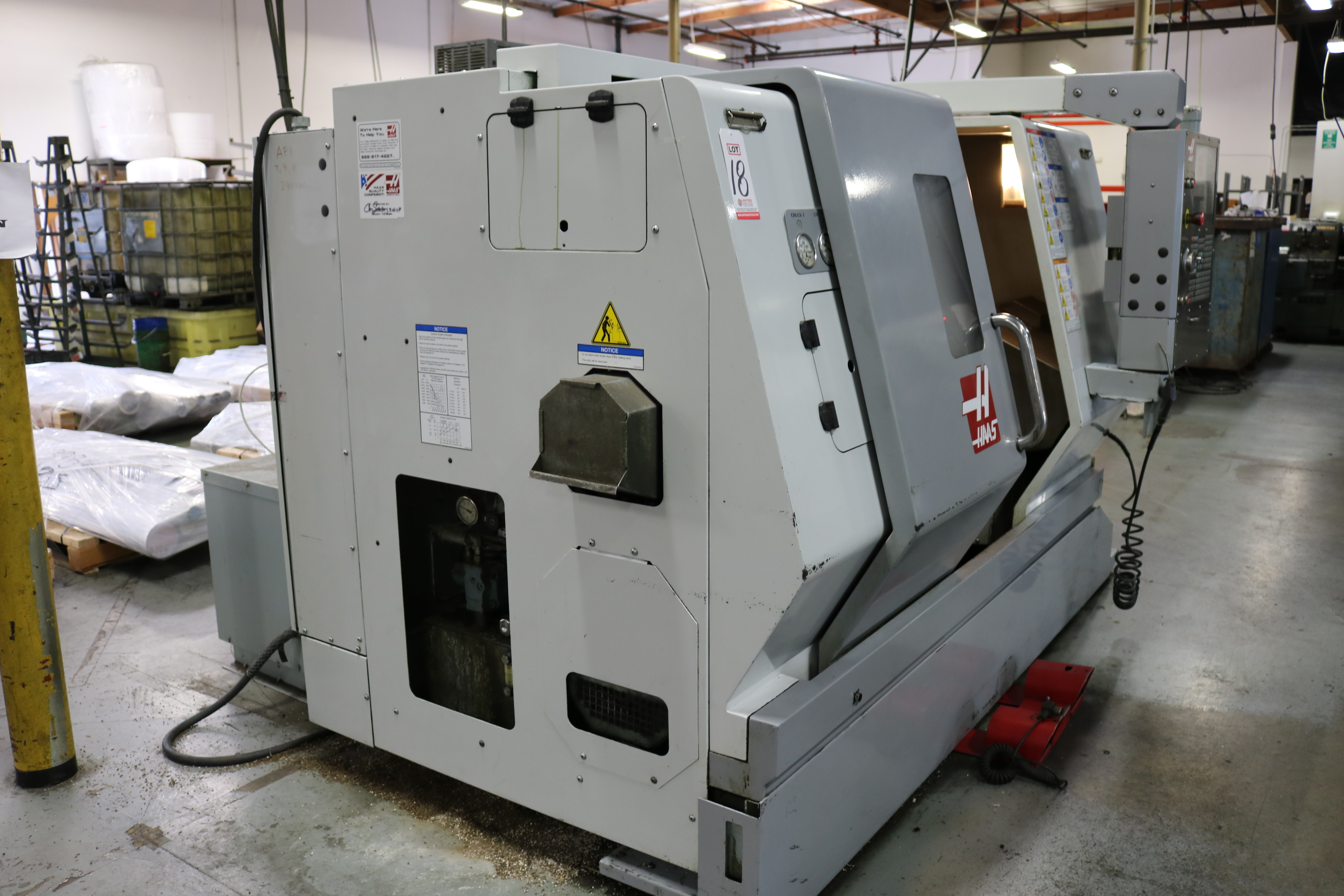"Lot 18 - 2007 HAAS TL-15 CNC TURNING CENTER, 8"" 3 JAW CHUCK 23"" SWING, 9.5"" SWING OVER CROSS SLIDE, 2"" BAR"