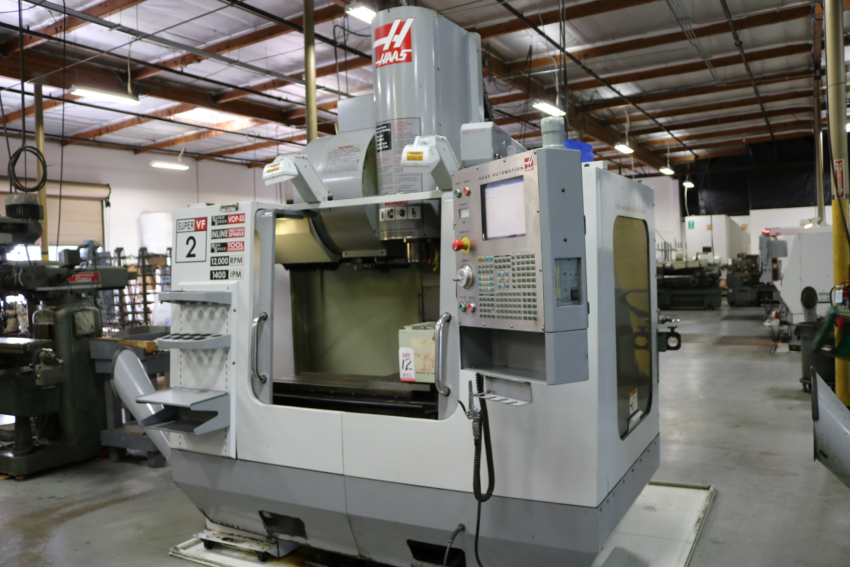 "Lot 11 - 2005 HAAS VF-2SS CNC VERTICAL MACHINING CENTER, TRAVELS: 30"" X 16"" X 20"", 36"" X 14"" TABLE, 12,000"